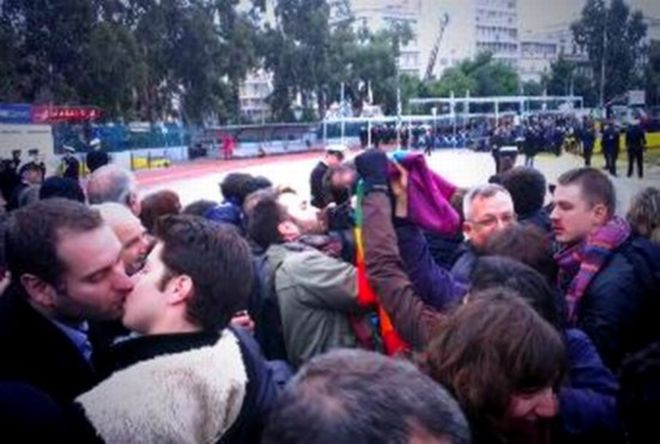 "picture of ""kiss in"" protest on January 6 in Piraeus, Greece"