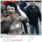Photo showing a man strangling a Femen activist around the throat in front of Crimea's parliament during a pro-Russian rally today. The woman's nipple is missing from the picture AFP Photo: Alexander Nemenov (photo censored as per Facebook rules)